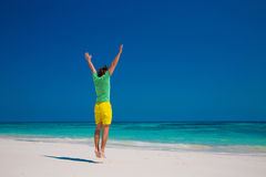 Freedom Beach Summer Holiday Concept. Handsome young man jumping Stock Images