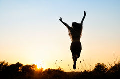Freedom, beautiful girl jumping Stock Image