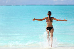 Freedom bikini woman splashing ocean water Royalty Free Stock Photos