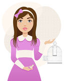 Freedom bird. Beautiful girl in the purple dress frees the bird out of the cage Stock Image