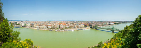 Freedom Bridge connecting Buda and Pest across Dunabe River in Budapest, Hungary - panoramic view from a hill Royalty Free Stock Photography