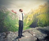Freedom. Businessman against a mountain and green panorama Royalty Free Stock Image