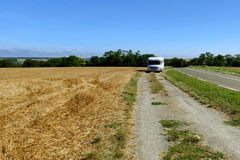 Freedom camping with camper motor home at agricultural field Royalty Free Stock Images