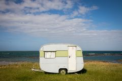 Freedom camping in caravan at an East Coast beach, Gisborne, North Island, New Zealand. Freedom camping in caravan on sand dunes at Pouawa Beach near Gisborne stock photography