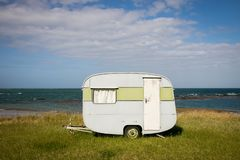 Freedom camping in caravan at an East Coast beach, Gisborne, North Island, New Zealand. Freedom camping in caravan on sand dunes at Pouawa Beach near Gisborne stock images