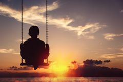Freedom and carefree of a young female on a swing Stock Photography