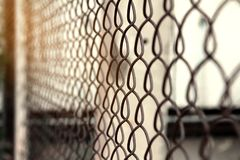 Freedom concept background,close up of a fence made of metal wire grids with rusty stock photo