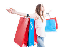 Freedom concept with beautiful shopaholic standing with arms wid Stock Image