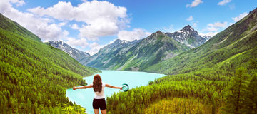 Freedom concept. Beauty girl in mountains on background view Kuc Royalty Free Stock Photos