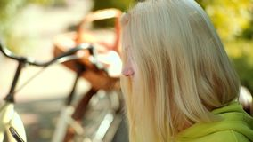 Freedom concept. Close up portrait girl with blonde hair wearing autumn dress posing with coffee. Concept about morning. Coffee. 3G, 4G and mobile Internet stock video footage
