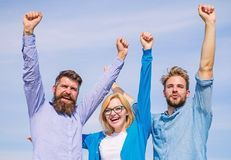 Freedom concept. Company happy colleagues office workers enjoy freedom friday evening, sky background. Employees enjoy. Feeling of freedom. Men with beard in royalty free stock photography