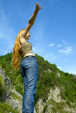 Freedom concept - happy woman on mountain high. Happy and victorious girl on top of a mountain Royalty Free Stock Photos