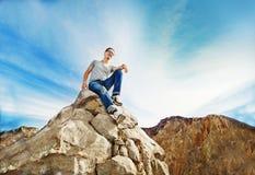 Freedom concept. Man on the peak of mountain Stock Photo