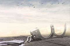 Freedom concept with a pair of open handcuffs stock photography