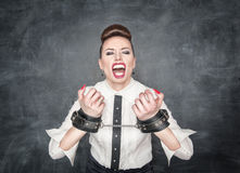 Freedom concept. Screaming business woman with handcuffs Stock Photography