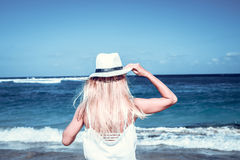 Freedom concept. woman on a beach of Bali island. She is enjoying serene ocean nature during travel holidays Stock Photography