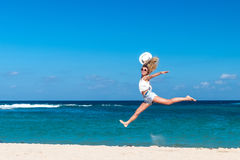Freedom concept. woman on a beach of Bali island. She is enjoying serene ocean nature during travel holidays. Freedom concept. woman on a beach. She is enjoying stock images