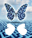 Freedom And Creativity. As an innovative businessman thinking outside the box escaping a maze or labyrinth by cutting out butterfly wings and taking flight Stock Photography