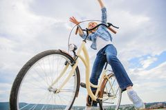 Freedom and delight. Most satisfying form of self transportation. Cycling gives you feeling of freedom and independence. Girl rides bicycle sky background stock photo