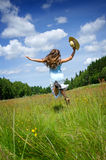 Freedom expression in summer field Royalty Free Stock Photo