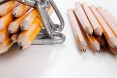Freedom of expression - true or false. Two piles of pencils - first wrapped up in chains, second without Stock Images