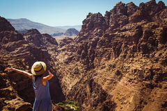 Freedom female wanderlust standing with raised hands enjoying majestic mountain landscape. Hipster young girl explore world. Summe. R vacation. Impressive nature Stock Photography