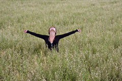 Freedom on the field. Woman feeling freedom in a field Royalty Free Stock Image