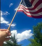 Freedom. Flying flag on Fourth of July Royalty Free Stock Photos