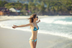 Freedom girl on the beach. Happy freedom woman enjoying summer on the tropical beach. Feedom concept Royalty Free Stock Photography