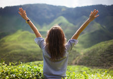 Freedom girl with hands up. In mountains Royalty Free Stock Photos