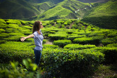 Freedom girl in mountains. On tea plantation Stock Image