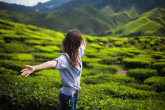 Freedom girl in mountains. On tea plantation Royalty Free Stock Images