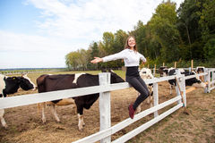 Freedom girl. Sitting on fence. Pause after work in milk farm. Outdoor Royalty Free Stock Images