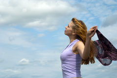 Freedom. Girl and sky. Young beautiful woman celebrates the freedom of nature Royalty Free Stock Photo