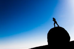 Freedom. A girl standing on a rock Royalty Free Stock Image