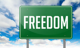 Freedom on Green Highway Signpost. Stock Photo