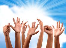Freedom hands. Hands raised against sky background Stock Photos