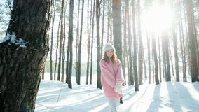 Freedom, happiness, beautiful girl walks in the woods fun, sun`s rays shine through trees in the backlight, lot of snow stock video