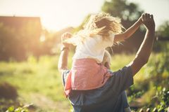 Freedom and happiness. Grandfather and granddaughter spending time together in nature. Carrying on shoulders. Copy space royalty free stock image