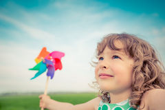 Freedom. Happy child in spring field. Young girl relax outdoors. Freedom concept Stock Photography