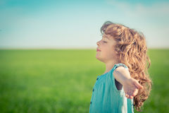 Freedom. Happy child in spring field. Young girl relax outdoors. Freedom concept Stock Photos