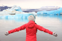 Freedom happy woman at glacier lagoon on Iceland Royalty Free Stock Photography