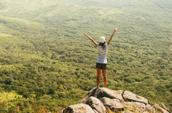 Freedom hiker on mountain. Freedom hiker woman in nature on mountain with raised arms enjoying happiness in beautiful landscape Stock Photo