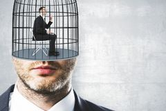 Freedom and innovation backdrop. Cage headed businessman on concrete wall backdrop with copyspace. Freedom and innovation concept Stock Photos