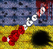 Freedom inscription on a brick wall in the colors of Ukrainian flag with traces of blood and bullets Stock Photo