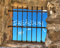Freedom by the jail bars Stock Photo