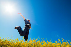 Freedom jump on the field Stock Photography