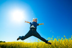 Freedom jump on the field Stock Images