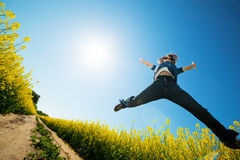 Freedom jump on the field Royalty Free Stock Photography