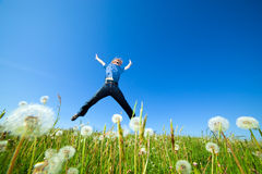 Freedom jump on the field Royalty Free Stock Photo